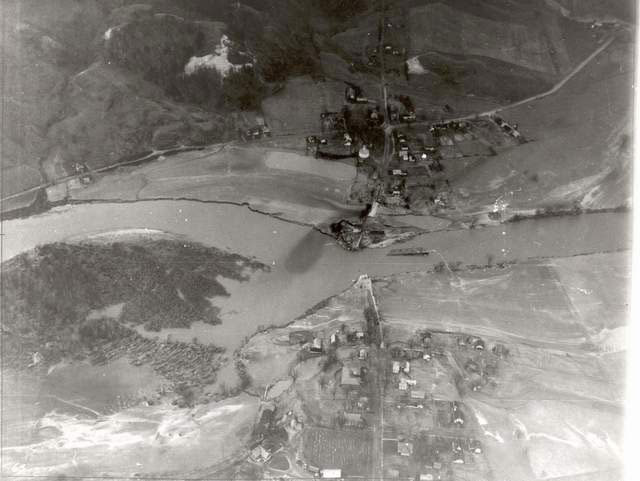 Aerial view of downtown Richmond, taken one week after 1927 flood.  Note the bridge knocked off its moorings in the river.